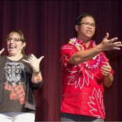 Two interpreters at a movie theater for open captioining in hawaii